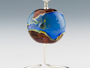 Ocean wrapped amber glass pendant